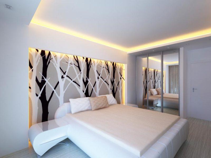 Achromatyczne kolory tapety w połączeniu z białymi meblami tworzą prostą i stylową aranżację