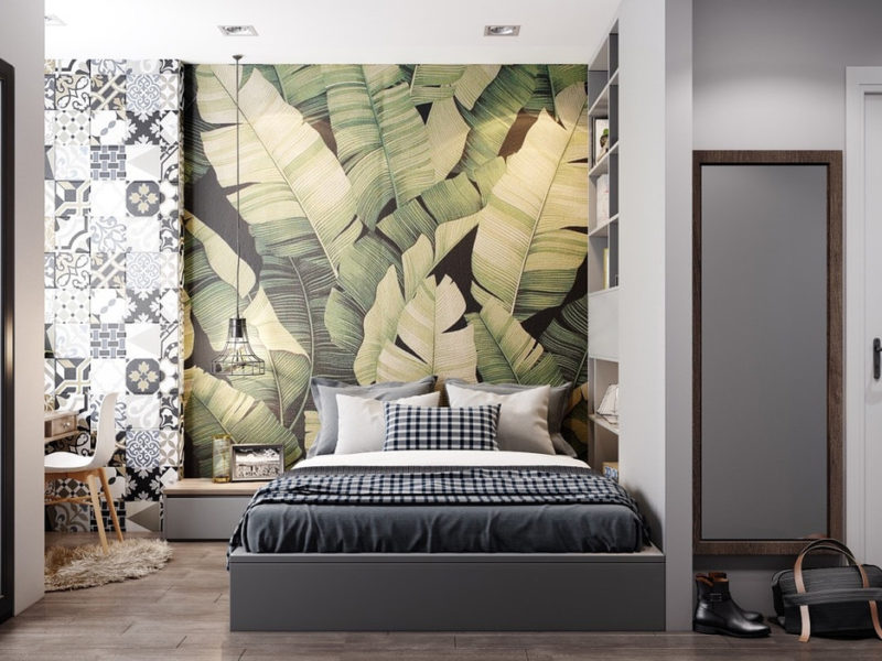 Tapeta z liśćmi nie musi być jedyną fototapetą we wnętrzu. Można połączyć je z monochromatycznym geometrycznym wzorem na sąsiedniej ścianie.
