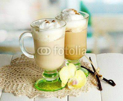 Fototapeta Fragrant coffee latte in glasses cups with spices,