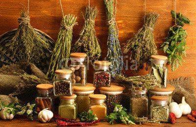 Fototapeta dried herbs, spices and and pepper, on wooden background