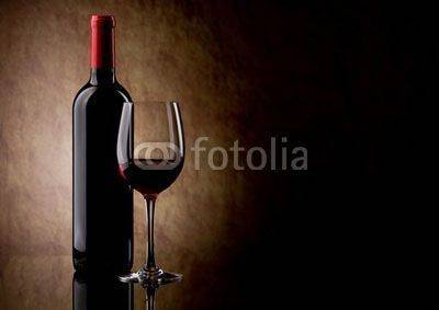Fototapeta bottle with red wine and glass and grapes