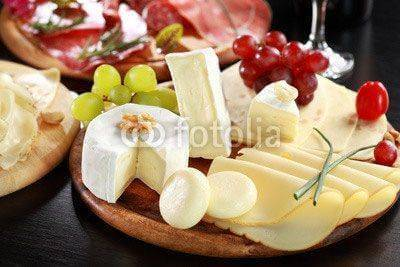Fototapeta Cheese and salami platter with herbs